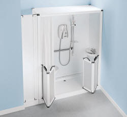 Shower toilet cubicle showing typical installation to an alcove. Note the side panel that conceals the toilet support frame, soil pipe and cistern