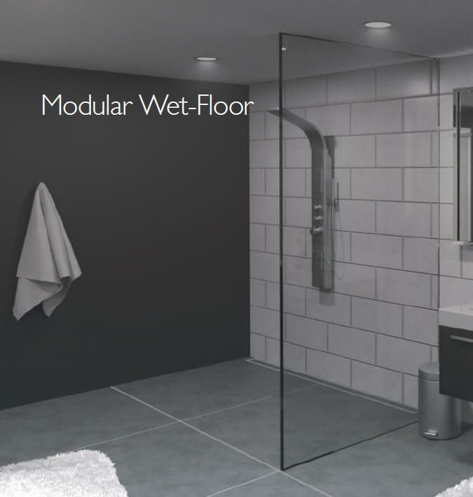 Modular system to create a floor in a wet room shower